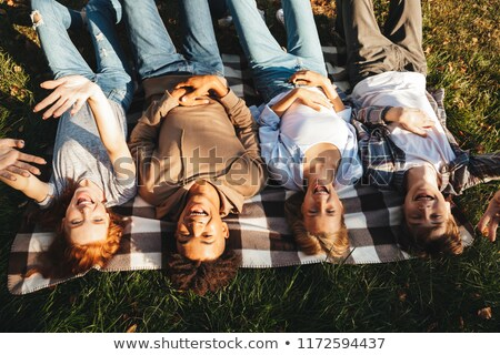top view of group of cheerful multhiethnic students stock photo © deandrobot