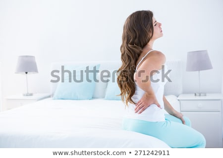 Beautiful Woman Suffering From Back Pain Stock photo © AndreyPopov