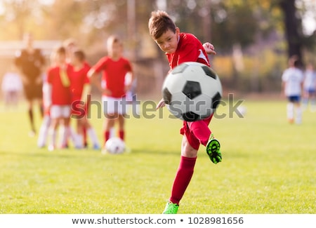 Football Action. Boys Kicking Football Match on Field Stock photo © matimix