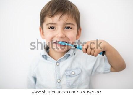 Chłopca zęby odizolowany szary twarz Zdjęcia stock © Lopolo