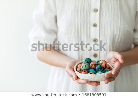 Boiled chicken eggs on a blue ceramic plate. The concept of Easter Holidays Stock photo © dash