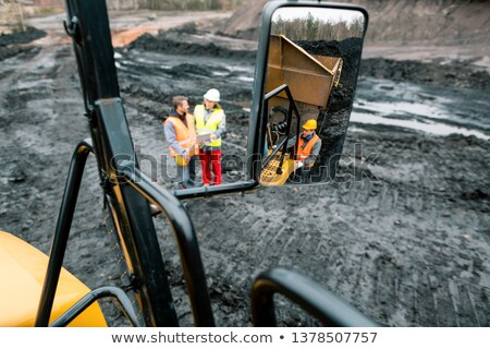 Stock photo: Workers in quarry seen in the mirror of a heavy-duty truck