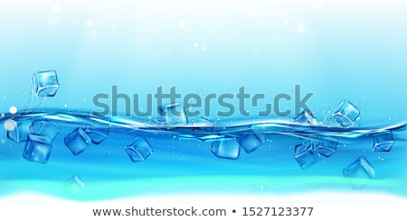 Stok fotoğraf: Ice Cubes Falling Under Water