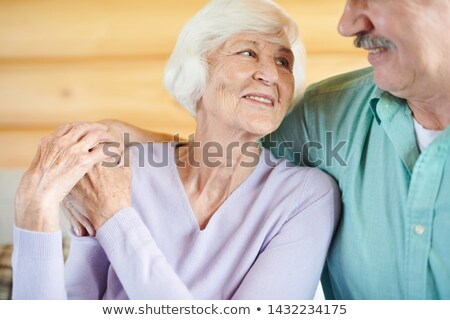 Happy mature casual spouses looking at one another with smiles Stock photo © pressmaster