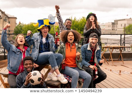 Young urban fans expressing gladness and cheering for their football team Stock photo © pressmaster