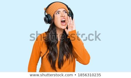 młoda · kobieta · słuchawki · śpiewu · biały · szczęśliwy · mikrofon - zdjęcia stock © pressmaster