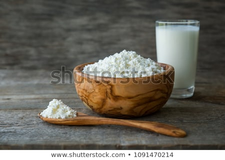 fresh dairy products on white table background glass of milk bowl of sour cream and cottage cheese stock photo © denismart