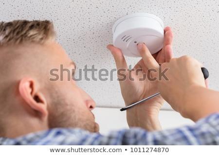 Szerelő installál füst detektor fal otthon Stock fotó © AndreyPopov