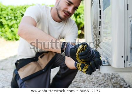 An Electrician Men Checking Air Conditioning Unit Stock photo © AndreyPopov
