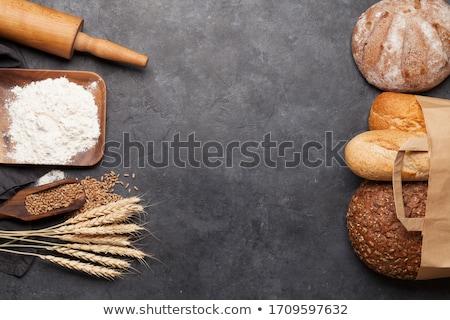 Various bread ingredients. Wheat, flour and cooking utensils Stock photo © karandaev
