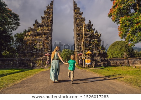 Mother and son walking through Traditional Balinese Hindu gate Candi Bentar close to Bedugul, Bratan Stock photo © galitskaya