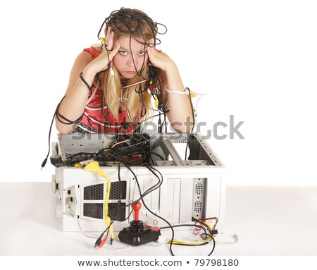 bored woman repairing computer stock photo © smithore