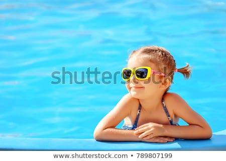 boldog · nyár · nő · napszemüveg · medence · portré - stock fotó © maridav