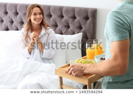 Man bringing breakfast to girlfriend Stock photo © photography33