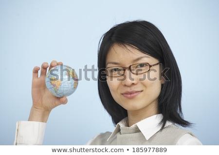 Woman holding small globe Stock photo © photography33