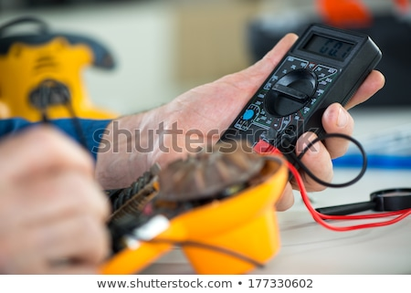 Electricians using multimeter Stock photo © photography33