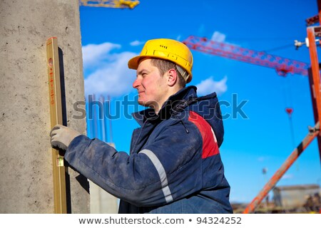 Construction worker using a bubble level Stock photo © photography33