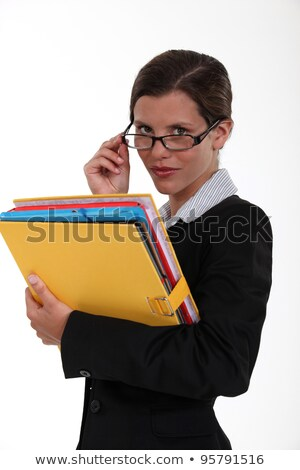 Secretary holding a binder and peering over her glasses Stock photo © photography33