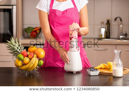 woman holding a blender stock photo © photography33