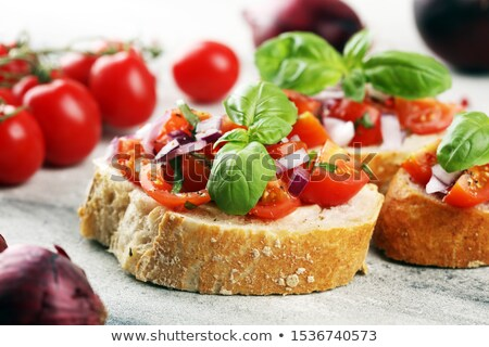bruschetta with tomato green olives garlic and basil stock photo © ildi