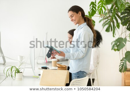 Young relocation staff member holding cardboard boxes Stock photo © stockyimages