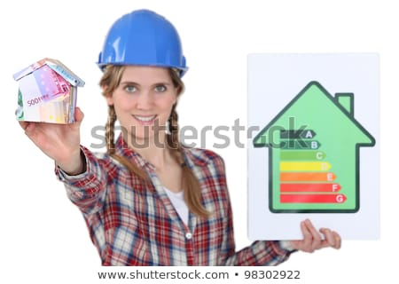 Tradeswoman holding efficiency rating sign Stock photo © photography33