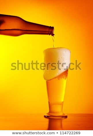 Waiter serving a bottle of beer Stock photo © photography33