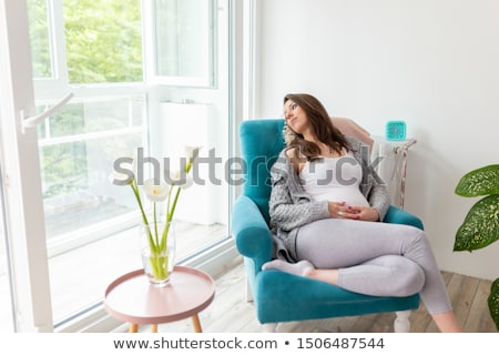 lovely woman with calla lilly Stock photo © dolgachov