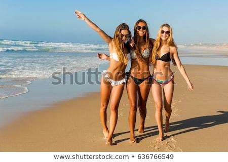 Fiatal csinos lány tengerpart sál napos Stock fotó © Studiotrebuchet