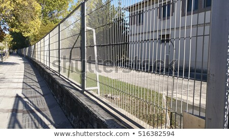 Stock photo: Pointed metal fence perspective