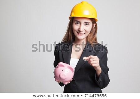 Engineer holding house of money Stock photo © photography33