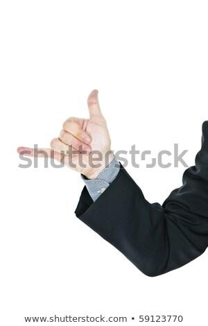 Man giving hang loose hand sign stock photo © elenaphoto
