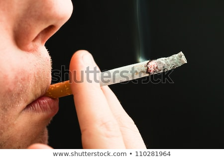 Close up of a cigarette lighted against a white background Stock photo © wavebreak_media