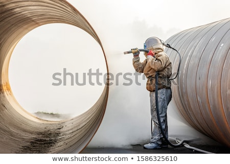 Sandblasting of metal structures at construction site Stock photo © rufous