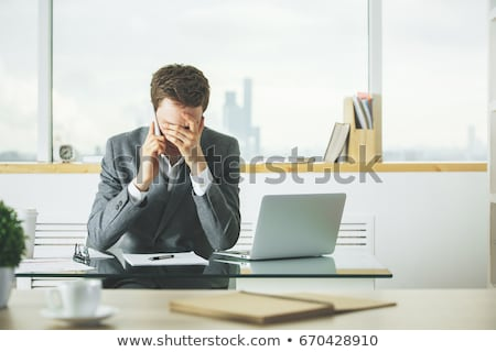 Worried man at office table Stock photo © stevanovicigor
