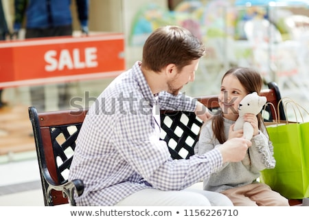 family on bench in shop stock photo © paha_l