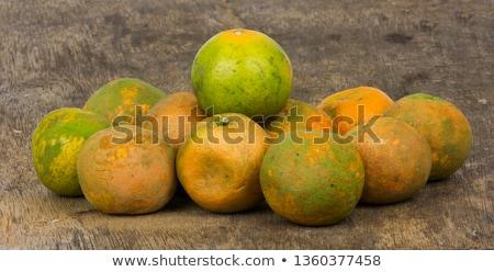Rotten orange citrus on the floor Stock photo © lunamarina