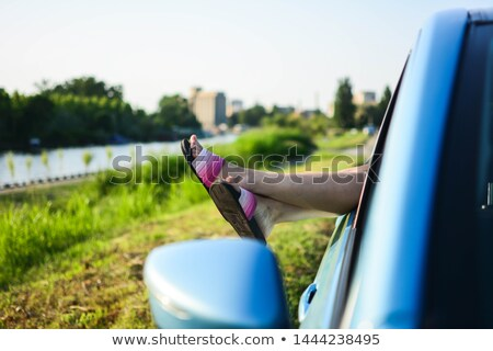 female legs in pink sandals out from the car summer trip concep stock photo © nobilior
