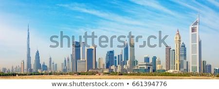 ストックフォト: ドバイ · スカイライン · ビジネス · 背景 · ホテル · シルエット