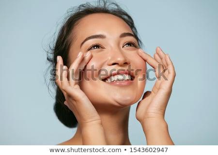Fiatal nő kezek arc gyönyörű visel póló Stock fotó © pxhidalgo