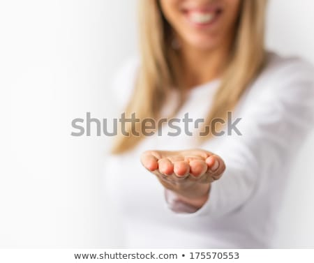 happy woman holding hands for product placement Stock photo © Rob_Stark