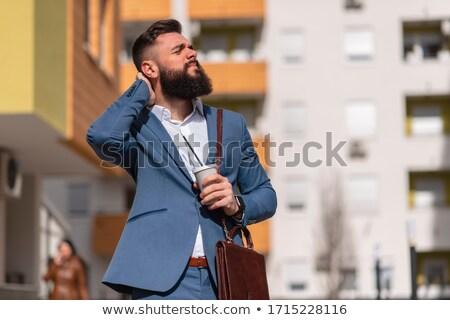 zakenman · keel · business · hand · gezicht - stockfoto © jackethead