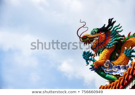 chinese style dragon statue and temple stock photo © witthaya