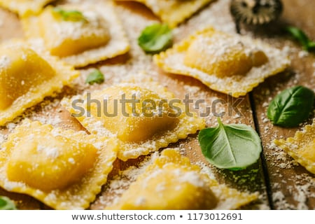 Nyers ravioli bazsalikom étel fa háttér Stock fotó © M-studio