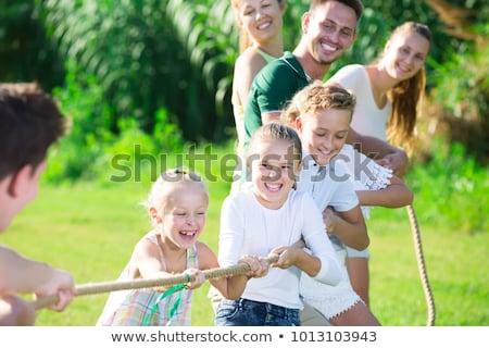 Family Tug-of-War Stock photo © lenm