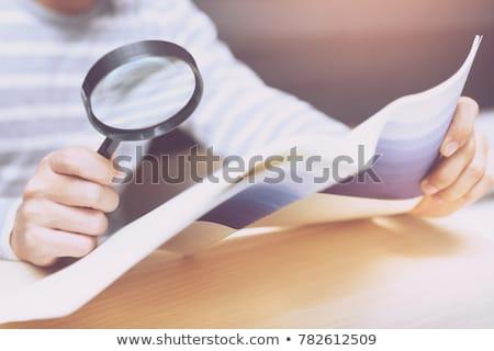 document management magnifying glass on old paper stock photo © tashatuvango