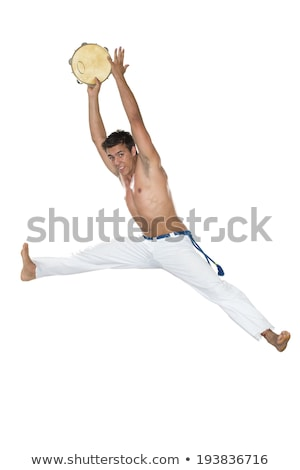capoeira brazilian man jumping with tambourine stock photo © brazilphoto