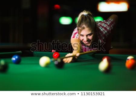 Beautiful blond woman playing billiards Stock photo © Nejron