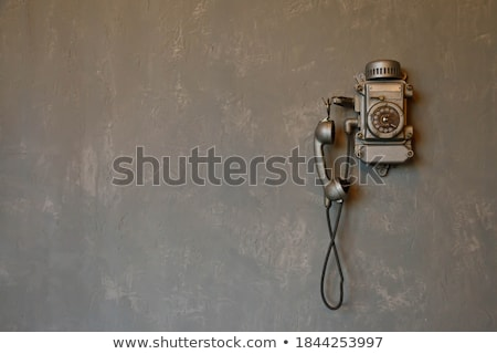 Vintage telephone on old wall concept background Stock photo © denisgo