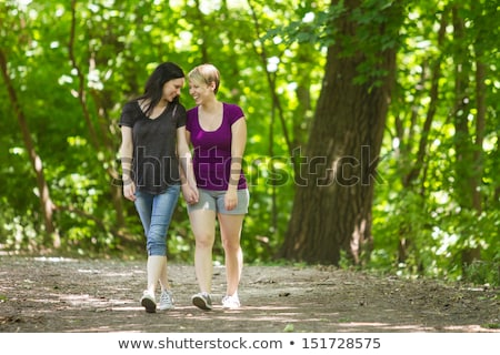 rear view of a lesbian couple walking together stock photo © bmonteny